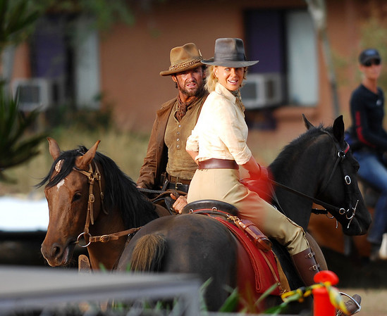 "BOWEN, QLD, AUSTRALIA 24 MAY 2007 - Nicole Kidman and Hugh Jackman on horseback during filming of ""Australia"", the Baz Luhrmann movie currently in production in Bowen - PHOTO: CAMERON LAIRD (PH 0418 238811)"