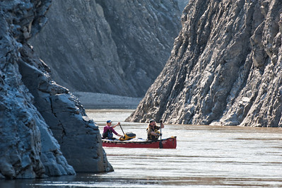 Canoists navigating the Peel Canyon. Peel River, Yukon Territory. Images from 2 week canoe trip through the Wind River in Northern Yukon, Canada. The Peel Watershed is located at the northern end of the Rocky and Mackenzie Mountain Chain.