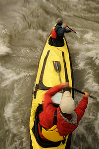 Overhead view of canoeist Peter Mather and Matt Ordish running rapids on the South Nahanni River. Nahanni National Park is a Unesco World Heritage site. The Nahanni River is also a Canadian Heritage River and one of the world's most popular paddling/canoeing destinations. Northwest Territories (NWT) Canada.