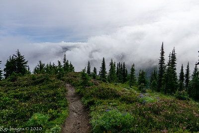 Clouds and the trail on the shoulder of Mount Pleasant above Spray Park