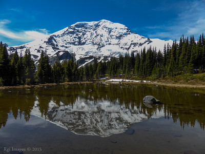 The Mountain reflected in a tarn between Moraine Park and Mystic Lake.