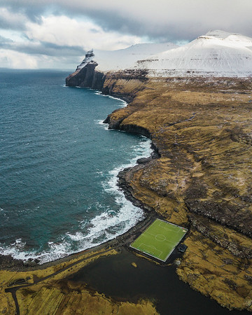 Football ground by the ocean