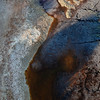 Stagnant water deposits colour the river banks of Rio Tinto Spain