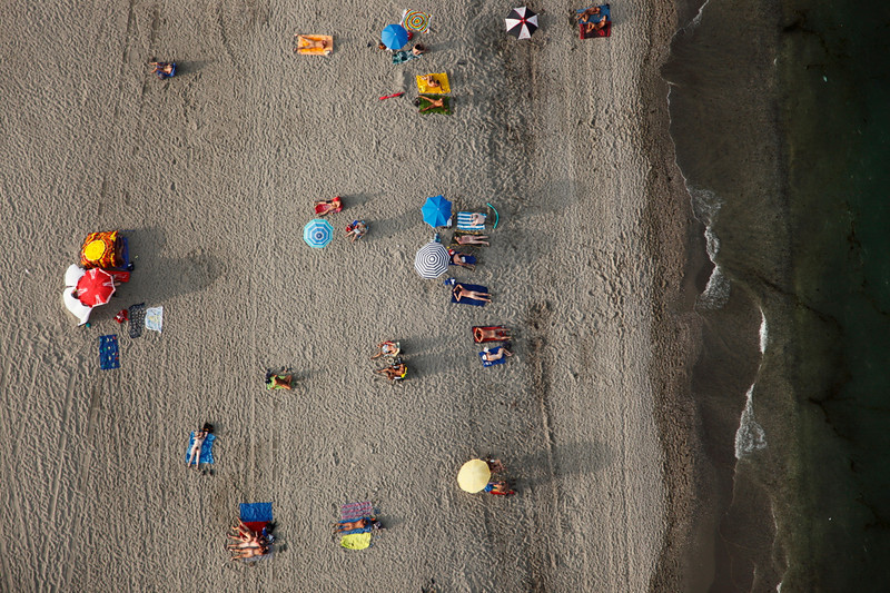 Bright colour contrasting flesh tones on a naturist beach Vera Spain