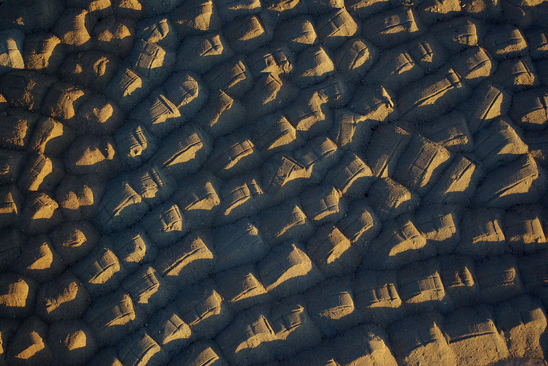 Piles of sand in the evening light.