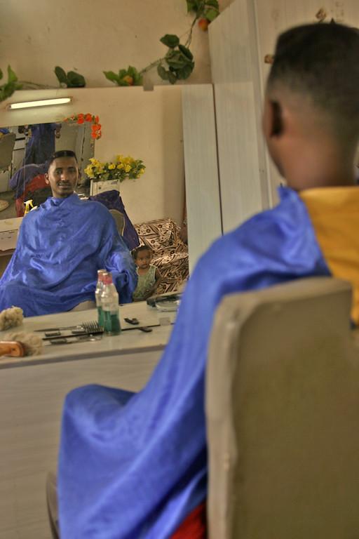 A man waits to get his hair cut in Massawa, Eritrea.