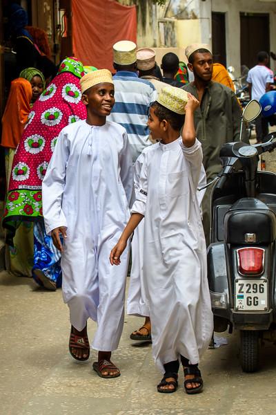 Boys wearing Kanzus and Kofias, Zanzibar
