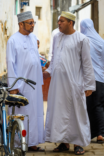 Men wearing Kanzus and Kofias, Zanzibar
