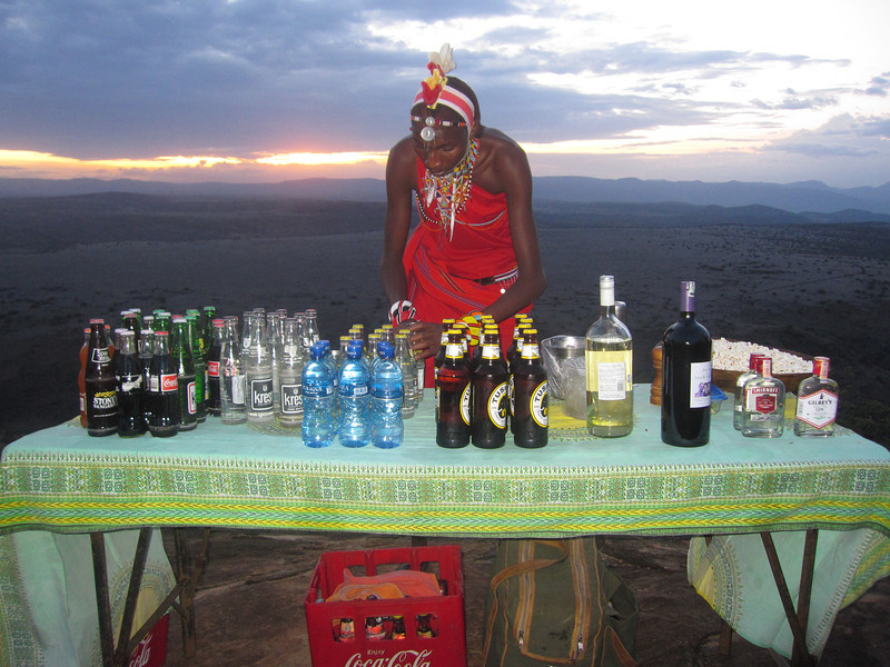 Evening time, after the 2nd game drive of the day, drinks and snacks at the mountaintop, courtesy of our Maasai guides and helpers.