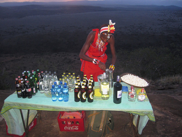 Maasai Simon fixing up the some emergency fluids after a long afternoon's shooting.