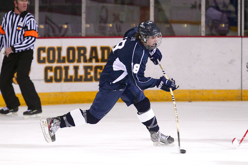 Air Academy senior Travis Work (18) takes a shot in the first period against Cheyenne Mountain. The Air Academy Kadets defeated the Cheyenne Mountain Indians 4-2 in boys' hockey action on Tuesday, December 5, 2014 at The Broadmoor World Arena. Photo by Isaiah J. Downing