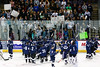 Air Academy celebrates in front of their fans following the game against Cheyenne Mountain. The Air Academy Kadets defeated the Cheyenne Mountain Indians 4-2 in boys' hockey action on Tuesday, December 5, 2014 at The Broadmoor World Arena. Photo by Isaiah J. Downing