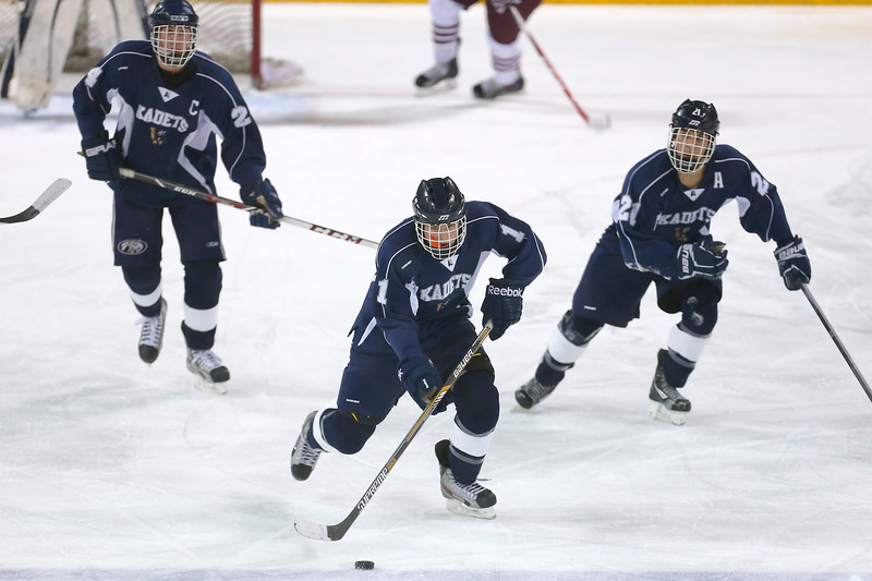 The Air Academy Kadets lead the puck up ice in the second period against Cheyenne Mountain. The Air Academy Kadets defeated the Cheyenne Mountain Indians 4-2 in boys' hockey action on Tuesday, December 5, 2014 at The Broadmoor World Arena. Photo by Isaiah J. Downing