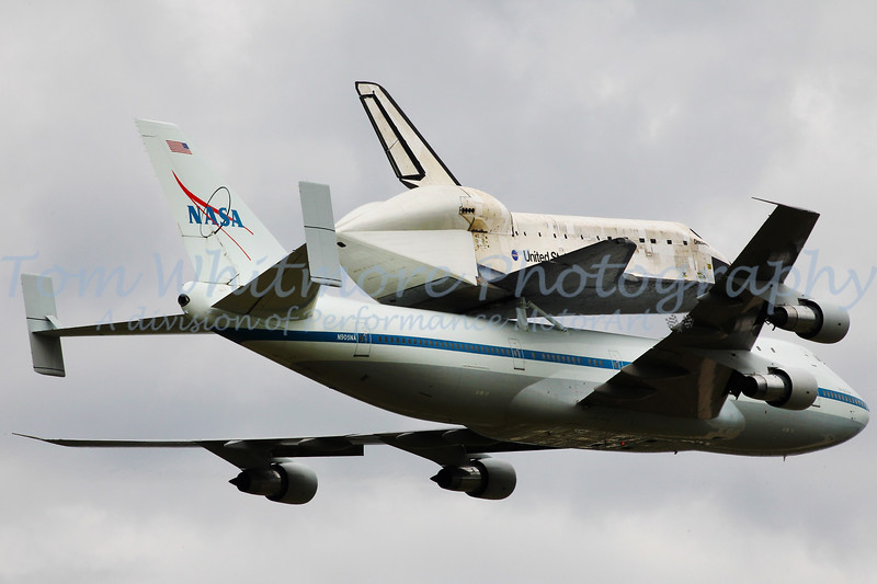 WASHINGTON — The space shuttle Discovery, NASA's fleet leader and the world's most-flown spacecraft, arrived in Washington, D.C. Tuesday (April 17), where it went on permanent display at the Smithsonian.<br /> The retired space plane was delivered to the nation's capital mounted to the space agency's Shuttle Carrier Aircraft, a modified Boeing 747 jumbo jet, on a final ferry flight that included a historic flyover of the National Mall and some of its nearby monuments and federal buildings.