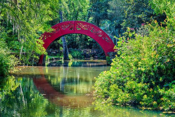 Reflection of the high-arch, vibrant Moon bridge creates the illusion of a circle.  - Bellingrath Gardens, Alabama