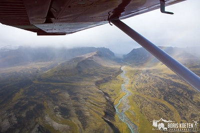 The Gates of the Aniakchak Caldera, from with the Aniakchak river flows down to the ocean. Aniakchak National Monument & Preserve, Alaska. As seen from a Cessna 185. (This image is not for sale).
