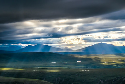 Sunlight filters through the clouds on a July evening in Alaska's eastern Interior.  Filename: AKA-14-4256-502.jpg