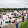 "And they're off! Participants of the 2013 Red Green Regatta push off from the shore and float down river.  <div class=""ss-paypal-button"">Filename: AKA-13-3885-54.jpg</div><div class=""ss-paypal-button-end"" style=""""></div>"