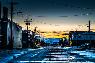 The sun sets behind downtown Nome, site of UAF's Northwest Campus.  Filename: AKA-16-4865-540.jpg
