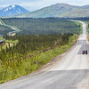 "Cyclists make their way along a lonely stretch of the Dalton Highway which mostly parallels the trans-Alaska pipeline from just north of Fairbanks to Deadhorse near the Arctic Ocean.  <div class=""ss-paypal-button"">Filename: AKA-14-4213-053.jpg</div><div class=""ss-paypal-button-end""></div>"
