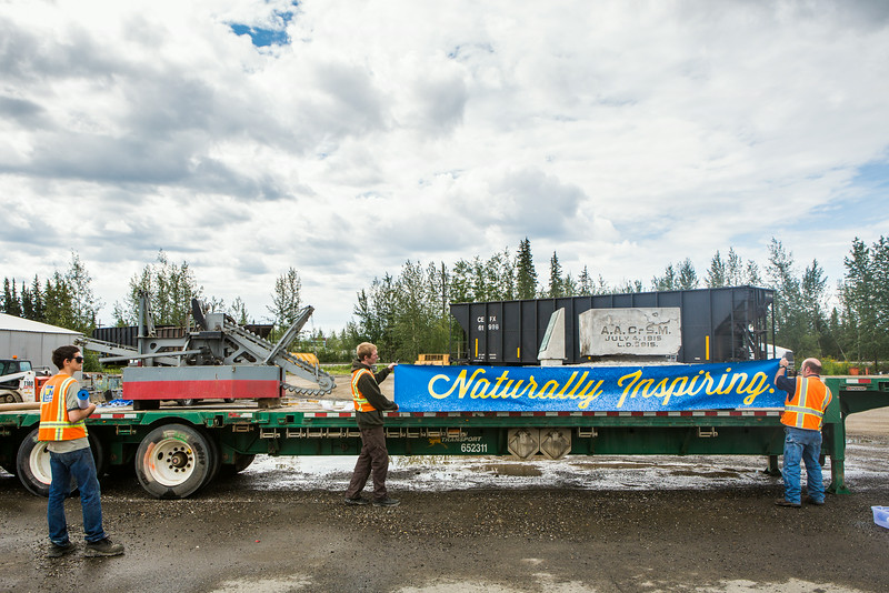 """Facility Services prepares the 2014 Golden Days float with the UAF Cornerstone.  <div class=""""ss-paypal-button"""">Filename: AKA-14-4248-6.jpg</div><div class=""""ss-paypal-button-end""""></div>"""