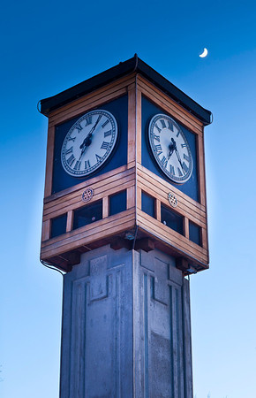 A crescent moon shines above the clock tower in Golden Heart park in downtown Fairbanks.  Filename: AKA-11-3008-10.jpg