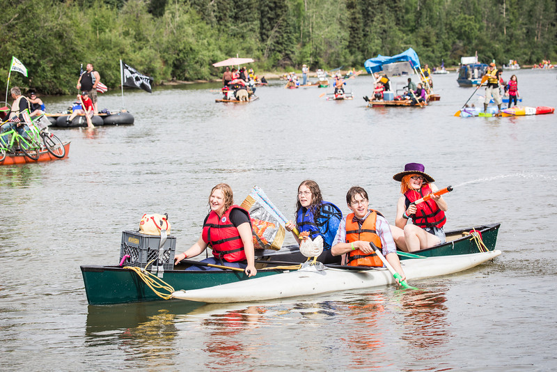 """Participants of the 2013 Red Green Regatta float down the Chena River.  <div class=""""ss-paypal-button"""">Filename: AKA-13-3885-115.jpg</div><div class=""""ss-paypal-button-end"""" style=""""""""></div>"""