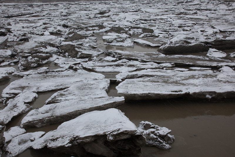 "Ice chunks clog up the bay leading to Dillingham's primary boat harbor during breakup in late April.  <div class=""ss-paypal-button"">Filename: AKA-12-3406-036.jpg</div><div class=""ss-paypal-button-end"" style=""""></div>"