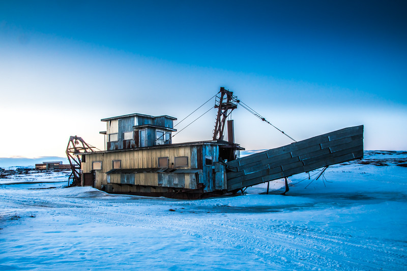 """An abandoned gold dredge just south of town reminds visitors and residents of Nome's gold mining history.  <div class=""""ss-paypal-button"""">Filename: AKA-16-4865-520.jpg</div><div class=""""ss-paypal-button-end""""></div>"""