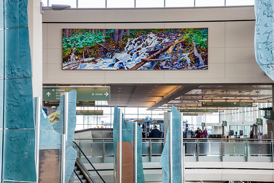 A large mural painted by UAF associate professor David Mollett hangs prominently in the Ted Stevens International Airport in Anchorage.  Filename: AKA-12-3394-03.jpg