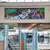 "A large mural painted by UAF associate professor David Mollett hangs prominently in the Ted Stevens International Airport in Anchorage.  <div class=""ss-paypal-button"">Filename: AKA-12-3394-03.jpg</div><div class=""ss-paypal-button-end"" style=""""></div>"