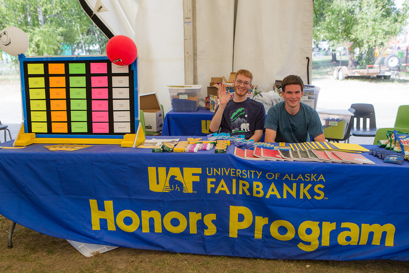 """Honors students Mathew Carrick, left, and Dillon Ball, host a trivia game during UAF Day at the Tanana Valley State Fair.  <div class=""""ss-paypal-button"""">Filename: AKA-13-3900-122.jpg</div><div class=""""ss-paypal-button-end"""" style=""""""""></div>"""