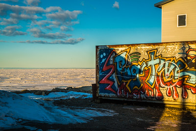 Grafitti is found on a container near the waterfront in Nome, site of UAF's Northwest Campus.  Filename: AKA-16-4865-168.jpg