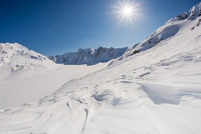 Wind blown patterns in the snow near the Jarvis Glacier in the eastern Alaska Range.  Filename: AKA-13-3795-147.jpg