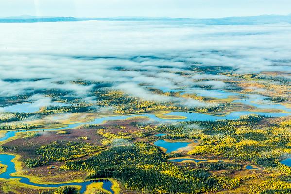 "Low clouds break up the view over an Interior Alaska autumn landscape.  <div class=""ss-paypal-button"">Filename: AKA-13-3929-66.jpg</div><div class=""ss-paypal-button-end""></div>"