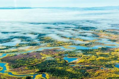 Low clouds break up the view over an Interior Alaska autumn landscape.  Filename: AKA-13-3929-66.jpg