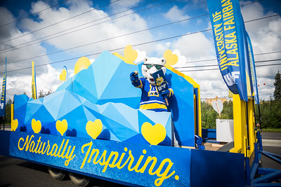 The Nook dances on board UAF's 2016 Golden Days parade float as UAF students, staff, faculty, alumni and administrators participate in representing the university.  Filename: AKA-16-4939-155.jpg