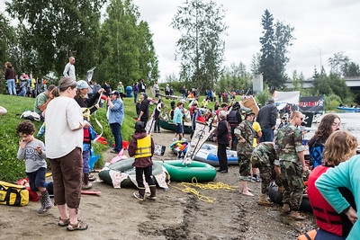 Participants in the 2013 Red Green Regatta prepare their floats on the banks of the Chena River.  Filename: AKA-13-3885-27.jpg