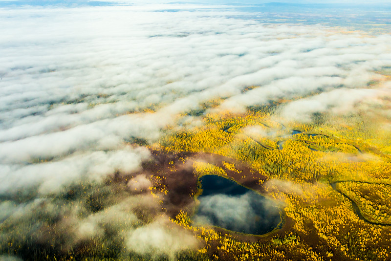 "Low clouds break up the view over an Interior Alaska autumn landscape.  <div class=""ss-paypal-button"">Filename: AKA-13-3929-60.jpg</div><div class=""ss-paypal-button-end""></div>"