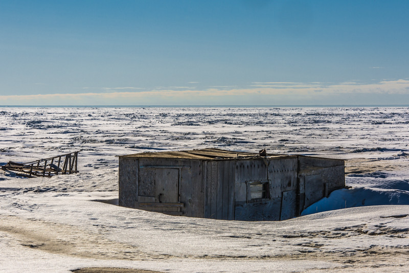 "A shacks and an abandoned dog sled adorn the beach just east of Nome, site of UAF's Northwest Campus.  <div class=""ss-paypal-button"">Filename: AKA-16-4865-138.jpg</div><div class=""ss-paypal-button-end""></div>"