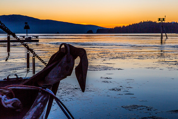 """An anchor contrasts with ice on the water at sunset at the Auke Bay harbor near Juneau.  <div class=""""ss-paypal-button"""">Filename: AKA-14-4059-297.jpg</div><div class=""""ss-paypal-button-end"""" style=""""""""></div>"""