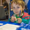 "Four-year-old Oscar Misel stops by the UAF information booth to pick up a sticker and a pencil during his visit during UAF Day at the Tanana Valley State Fair.  <div class=""ss-paypal-button"">Filename: AKA-12-3486-073.jpg</div><div class=""ss-paypal-button-end"" style=""""></div>"