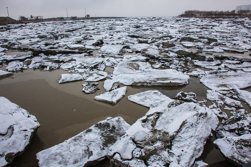 """Ice chunks clog up the bay leading to Dillingham's primary boat harbor during breakup in late April.  <div class=""""ss-paypal-button"""">Filename: AKA-12-3406-023.jpg</div><div class=""""ss-paypal-button-end"""" style=""""""""></div>"""