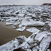 "Ice chunks clog up the bay leading to Dillingham's primary boat harbor during breakup in late April.  <div class=""ss-paypal-button"">Filename: AKA-12-3406-023.jpg</div><div class=""ss-paypal-button-end"" style=""""></div>"