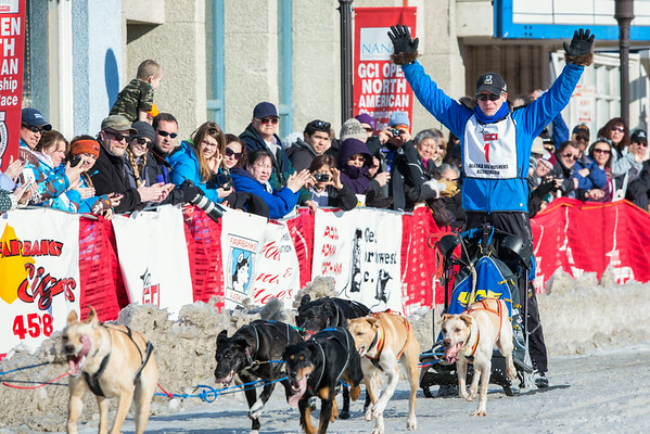 """With hands in the air as he crosses the finish line Associate Professor and Associate Dean of Veterinary Medicine Arleigh Reynolds clinches the first place of the 2014 Open North American Sled Dog Race in downtown Fairbanks.  <div class=""""ss-paypal-button"""">Filename: AKA-14-4120-44.jpg</div><div class=""""ss-paypal-button-end""""></div>"""