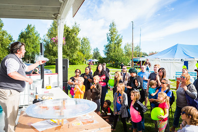 Attendees of the 2016 Tanana Valley State Fair receive a physics demonstration from Professor David Newman.  Filename: AKA-16-4953-135.jpg