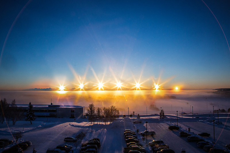 "The sun rises and sets above the Alaska Range south of Fairbanks in this composite image taken from the Akasofu Building on the UAF campus on Dec. 21, the day of the winter solstice.  <div class=""ss-paypal-button"">Filename: AKA-12-3685-comp.jpg</div><div class=""ss-paypal-button-end"" style=""""></div>"