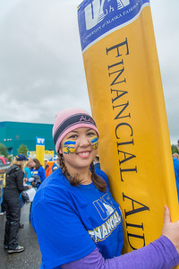 More than 200 UAF students, staff, faculty and administrators turned out to participate in the 2013 Golden Days parade through downtown Fairbanks.  Filename: AKA-13-3886-22.jpg