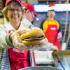 "Ann Ringstad, UAF's Community Advocacy director, serves up a tasty double during her shift at the UAF Alumni Hamburger Booth Tuesday at the Tanana Valley State Fair.  <div class=""ss-paypal-button"">Filename: AKA-12-3486-101.jpg</div><div class=""ss-paypal-button-end"" style=""""></div>"