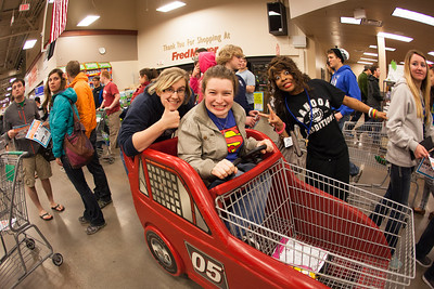 Students stock up on items during Fred Meyer's Midnight Extravaganza Wednesday morning, August 29, 2012 during New Student Orientation.  Filename: AKA-12-3520-4.jpg
